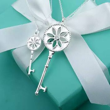 Tiffany & Co. White Daisy Key Necklace
