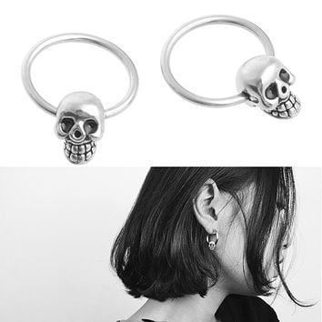 The Ghosted Skull Ear Piercing