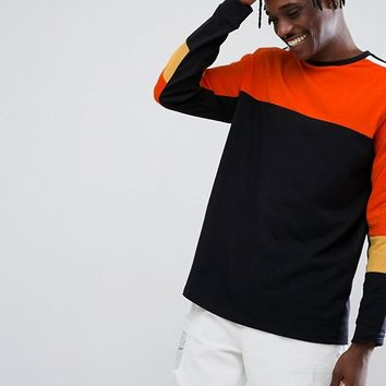 ASOS Oversized Long Sleeve T-Shirt With Bright Colour Blocking And Monochrome Taping at asos.com