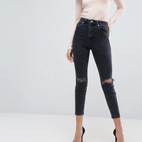 ASOS Super High Rise Firm Skinny Jeans with Busted Knees in Washed Black at asos.com