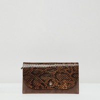 ASOS DESIGN suede and snake mix stud foldover purse at asos.com