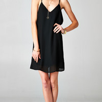 PLUNGING T-BACKLESS BLACK DRESS