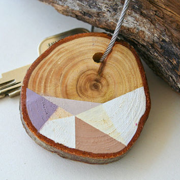 Pine wood keychain with stainless steel cable wire, tones of pink, brown, purple and ivory geometric triangle shapes
