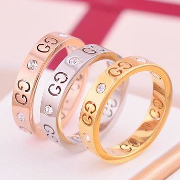 GUCCI Fashion Couple Simple Logo Hollow Geometric Pattern Diamond Ring Titanium Steel Tail Ring Joint Ring