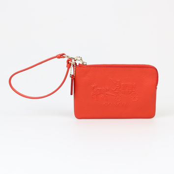 Coach Embossed Horse and Carriage Small Orange Wristlet