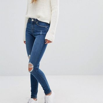 Miss Selfridge Mid Blue Busted Knee Jeans at asos.com
