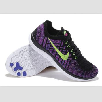 NIKE casual lightweight knitted running shoes Black and purple