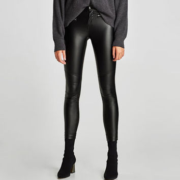 COATED TROUSERS WITH ZIPS DETAILS