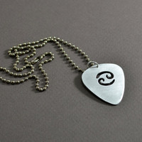 Zodiac guitar pick pendant in aluminum with personalized horoscope sign