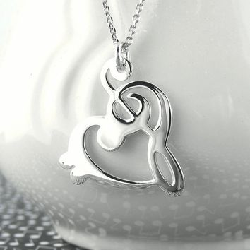 Treble & Bass Clef Heart Necklace in Sterling Silver