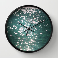sparks of hope Wall Clock by Marianna Tankelevich