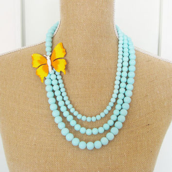 Aqua Blue Multi Strand Statement Necklace Vintage Orange and Yellow Enamel ButterflyAsymmetrical Aqua Glass Beaded Statement Necklace OOAK