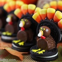 Peanut Butter Cup and Candy Corn Turkeys sitting on a Double Stuffed Oreo Cookie. Too cute, right What fun!!