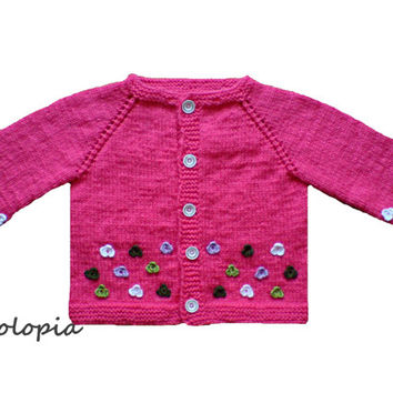 Baby cardigan, jacket, sweater for infant and toddlers; sugar pink, embellished with hand crocheted flowers. Handknit