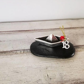 Paperboat metal sculpture, tiny sculpture of paperboat with '18' new year charm, silver paperboat sculpture on black stone, gouri varka '18'