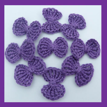 9 small  purple crochet bows, appliques and embellishments