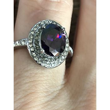 A Natural 2.65CT Oval Cut Purple Amethyst Double Halo Ring