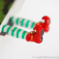 Elf in the book bookmark. Red shoes, green stripes. Funny christmas children gift. Fun for kids, children, all, her, office, host