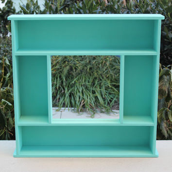Hand-built turquoise chalk painted wood display cabinet with mirror
