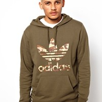 Adidas Originals Hoodie with Camo Trefoil at asos.com