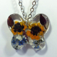 Butterfly Flower jewelry pendant necklace charm. Genuine flowers dried and suspended in resin. Unique botanical. Handcrafted.