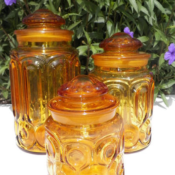 Amber Moon and Stars Canisters. Mid Century. Vintage Canisters. 1950s - 1960s. Kitchen. Yellow Canisters. Glass. Kitchen Decor.