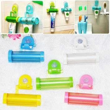 DCCKL72 DAY DAY FUN 2016 1 PCS Creative Rolling Squeezer Toothpaste Dispenser Tube Partner Sucker Hanging Holde distributeur dentifrice