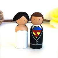 Clark Kent Lois lane Superman Wedding Cake by CreativeButterflyXOX