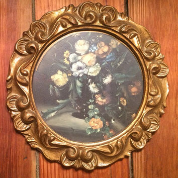 floral print in a circular carved vintage wooden frame, flower picture, ornate, wall hanging