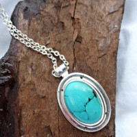 Sterling silver and green turquoise stone cameo style pendant necklace