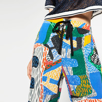 MULTICOLOURED PRINTED TROUSERS