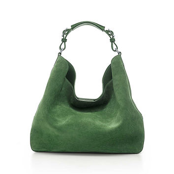 Tiffany & Co. - Chelsea bucket hobo in suede and smooth leather. More colors available.