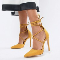 Public Desire Aries yellow tie up court shoes at asos.com