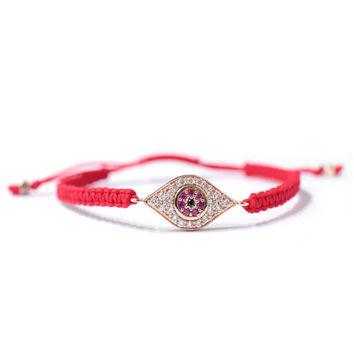 Red cord bracelets with gold plated eye pendant fashion accessory