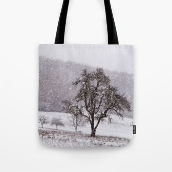 Old pear tree on a wintery meadow Tote Bag by Pirmin Nohr