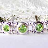 Peridot green rhinestone and olive green pearl double strand bracelet
