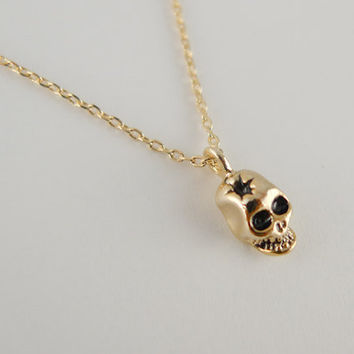 tiny gold skull necklace by LemonTreeLand on Etsy