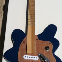 new(25 % off)Guitar on sale 3 stringed guitar (excellent christmas gift) and/or strings