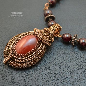 Handmade jewelry.  Necklace of handmade with beads. Pendant handmade from copper wire with cabochon from natural stone jasper.