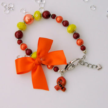 CRPS awareness bracelet with handmade ribbon charm in orange red and yellow