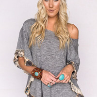 Knitted Gray Poncho with Ruffle Hem