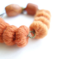 Chunky Orange Fiber Bracelet. Polymer Clay and Wool Yarn Beadwork Bracelet. Burnt Orange, Sienna and Light Orange Textile Jewelry.