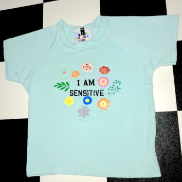 SWEET LORD O'MIGHTY! I AM SENSITIVE CROP TEE IN BLUE