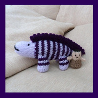 Knitted  dinosaur and cave man toys