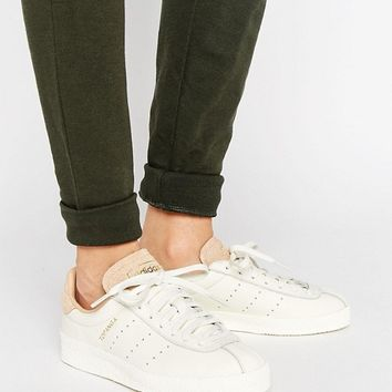 adidas Originals Topanga Unisex Sneakers In Cream Leather With Sand Suede Trim at asos.com