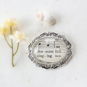 Sheet music brooch pin.  Vintage sheet music under glass in silver setting. Large accessory for music lover or musician