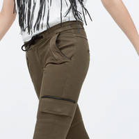 TROUSERS WITH FAUX LEATHER PIPING