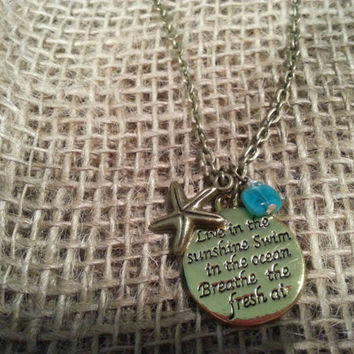Ocean sea themed necklace with quote & starfish charm and wire wrapped glass bead