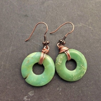 Jade green raw stone donut stone and copper wire wrapping earrings.