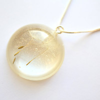 Beautiful Real Dandelion Seeds encased in a Crystal Clear Glass like resin Dome, attached to a Sterling Silver 18 inch Snake Chain